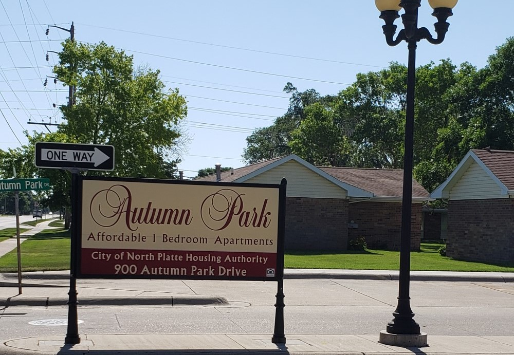 Second slide. Picture of autumn park's sign.